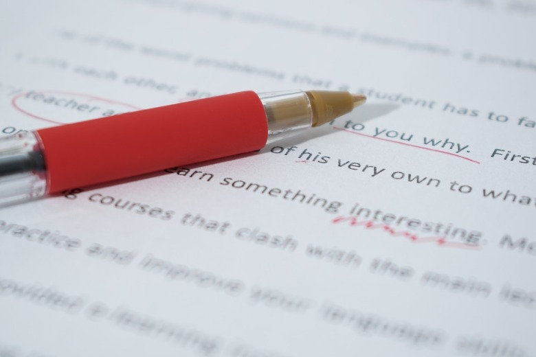 photo of a document being proofread and edited with red ink