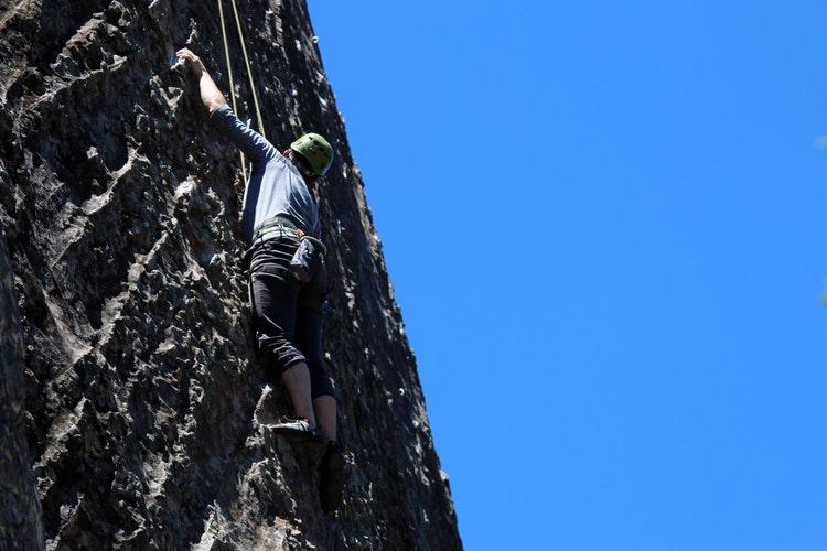 a man climbing a rock
